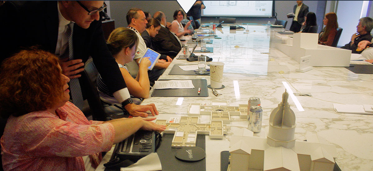 Photo of members of the City Arch River Universal Design Group reviewing designs using tactile models.